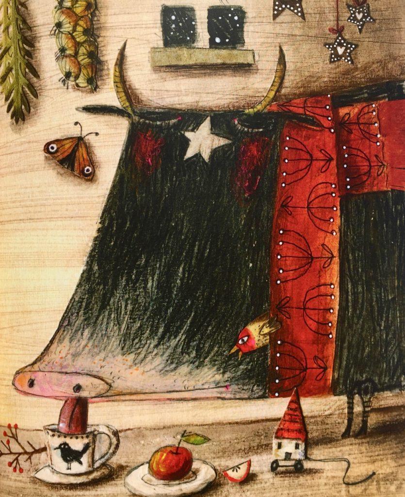 Il toro si gode il calduccio della sua casetta.
